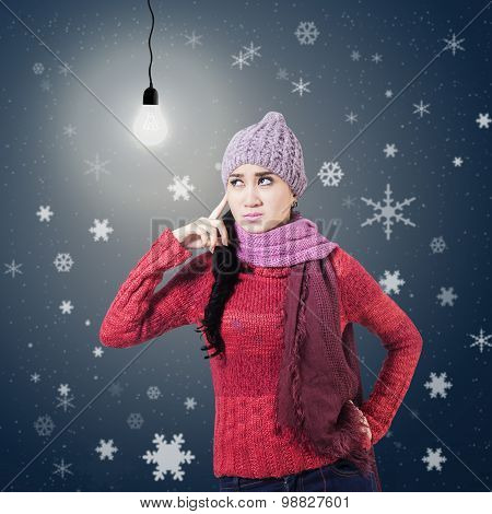 Winter Girl Thinking With Lightbulb