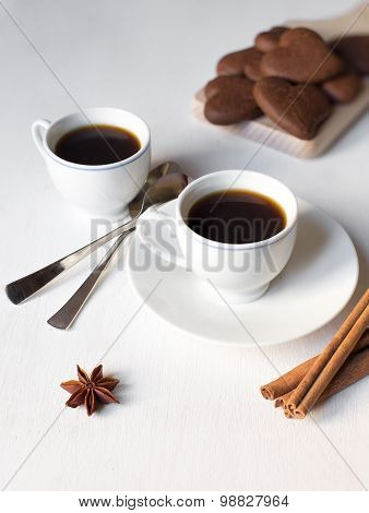 Two Cups Of Coffee On The White Table And With Two Spoons And Chocolate Cookies