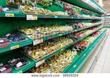 Shelf with vegetables, trademarks removed, price tags contain no copyright