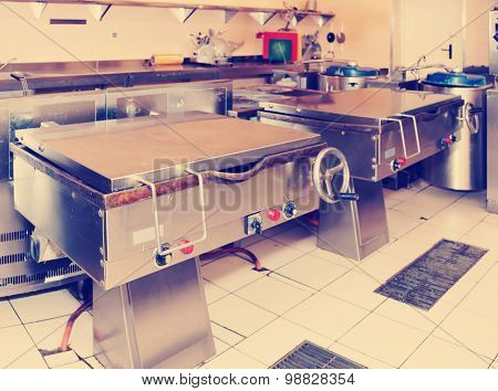 Typical kitchen of a big food processing plant, toned image