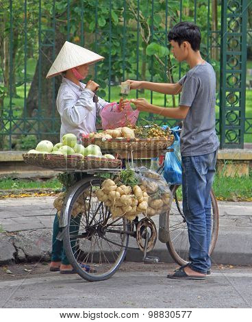 boy buys something at street seller