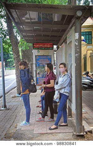 three women are waiting bus, Hanoi