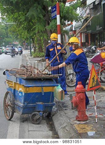two street cleaners are doing their work