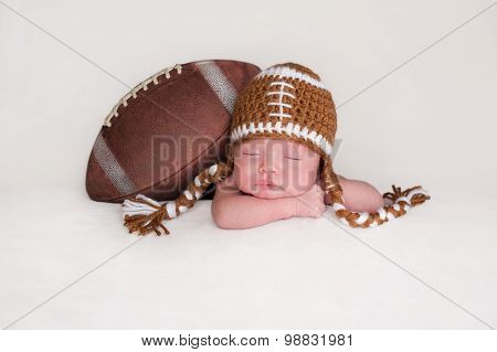 Newborn Baby Boy Wearing A Crocheted Football Hat