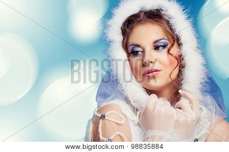 beautiful woman against blue background, Christmas topic