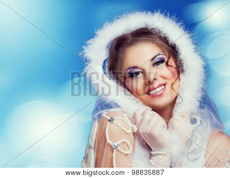 beautiful woman against colorful blue background, Christmas topic