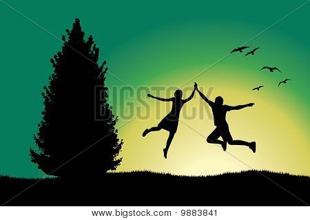 Man And Girl Holding For Hands And Jumping On Hill Near Spruce Tree, Green Background