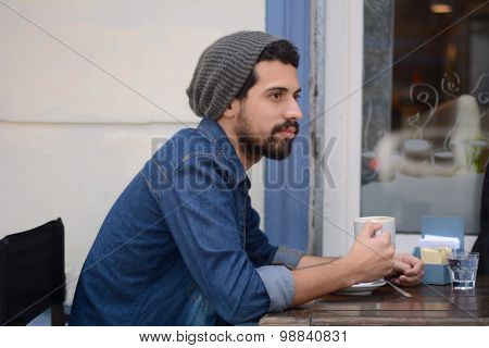 Young Man At An Outdoor Cafe.