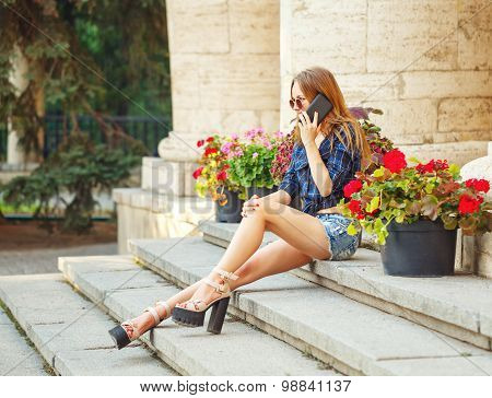 Hipster Girl In Shirt And Denim Shorts On Phone.