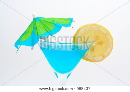 Detail Of Blue Cocktail With Lemon And Umbrella