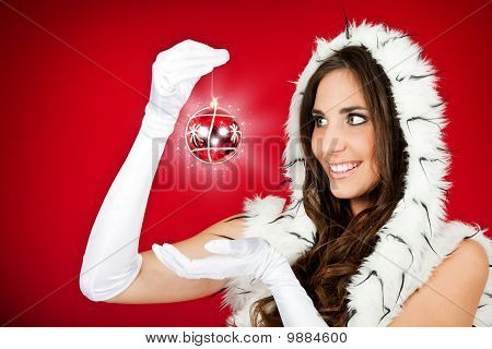 Woman In Santa Clothes Holding Shiny Xmas Ball