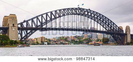 The Sydney Harbour Bridge is a steel through arch bridge across Sydney Harbour