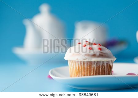 Colorful Muffin On Saucer With Flower Petal. Selective Focus