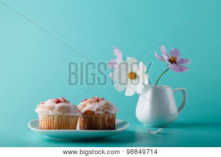 Colorful Muffin On Saucer With Flower