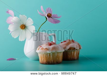 Muffin With Flower. Aqua Color Background