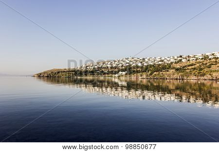 Reflection Of White Houses In Aegean Sea