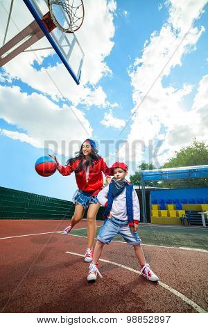 Rapper attitude rap singer hip Hop Dancer performing. Stylish woman and little boy playing basketbal