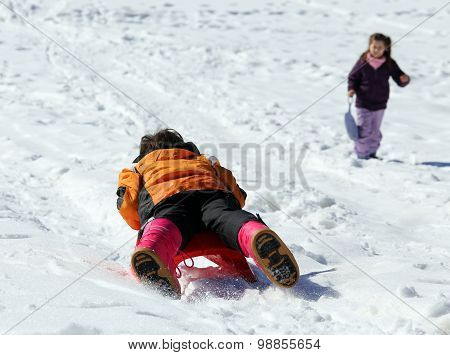 Children Plays With Sledging In Winter On The Snow