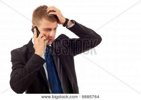 Pensive Business Man On The Phone