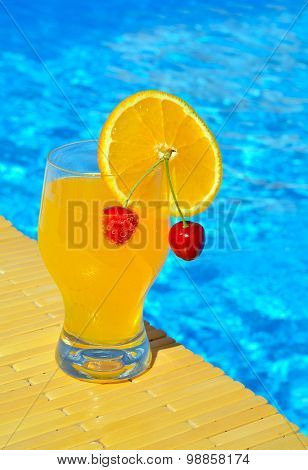 Cocktail Glass With Orange And Cherry
