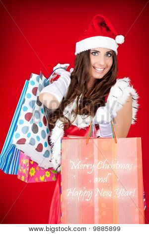 Sexy Santa Woman Holding Shopping Bags