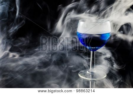 Glas With A Blue Liquid Used For Chemical Analysis..