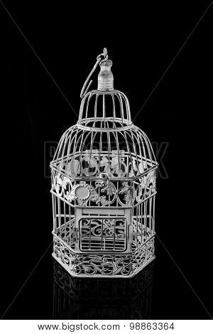 Isolated Bird Cage On A Black Background