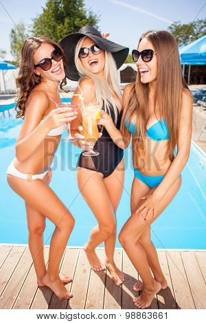 Beautiful young women are enjoying drinks on holidays
