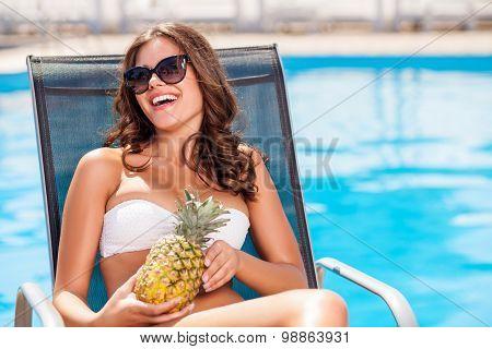 Beautiful young healthy girl is getting a suntan