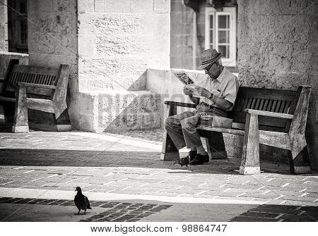 Senior Reading Newspaper In Valletta, Malta