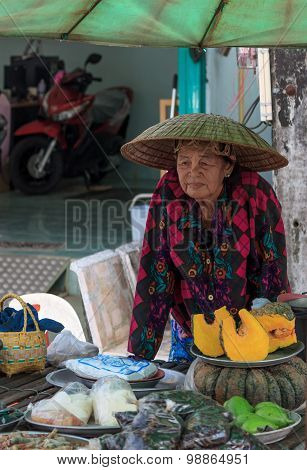 Unidentified Old Thai Woman Sells Fruits And Snacks In Street On July 22, 2015 In Chonburi, Thailand