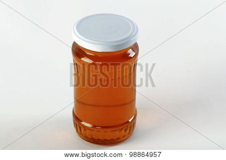 Honey Jar. Honey Tidbit In Glass Jar And Honeycombs Wax.
