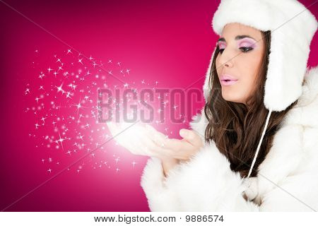 Winter Woman Blowing Snowflakes