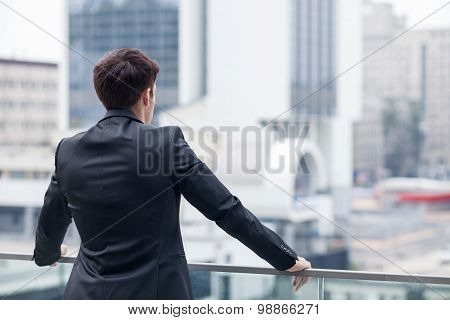 Successful young businessman is resting after work
