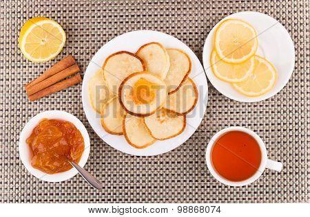 Tea With Pancakes, Peach Jam, Cinnamon Sticks And Lemon
