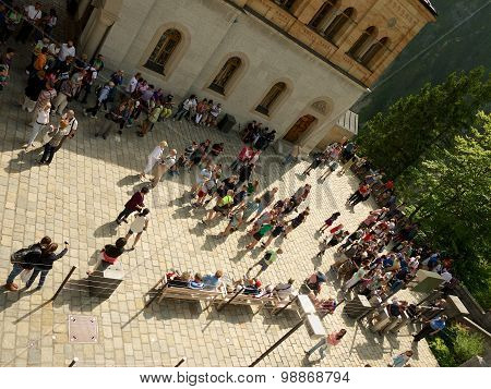 Tourists Waiting On Court Of The Neuschwanstein Castle