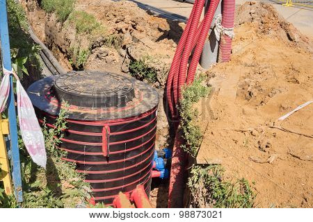 Excavation Pit, Electrical Cables And Optical Fibres In The Digging On A Construction Site