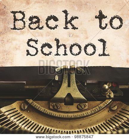 black vintage typewriter with bakc to school