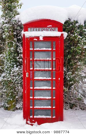 Red British Phonebox In The Snow