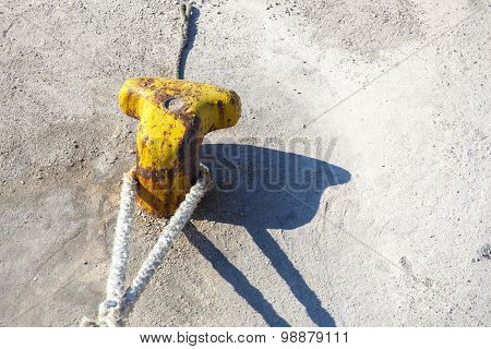 Mooring Bollard With A Rope On A Pier