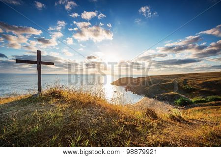 Christian Cross On A Wild Beach With A Wonderful Sunrise