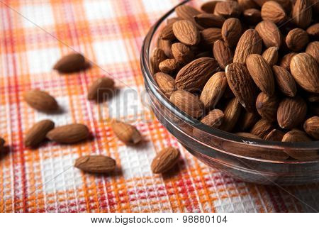 Large Grains Of Almonds In The Shell And The Bowl