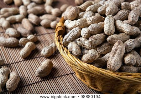 Large Grains Of Peanuts In The Shell And Basket