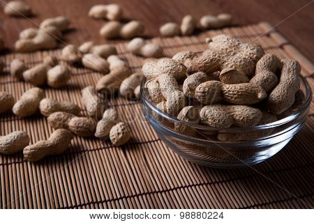Large Grains Of Peanuts In The Shell And The Bowl