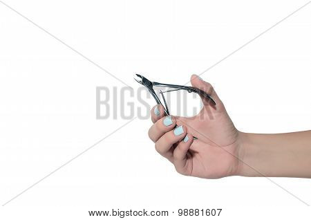 Nail Clipper In A Woman Hand With Blue Manicure