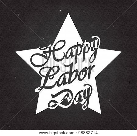 Happy Labor Day text in white star on black chalkboard