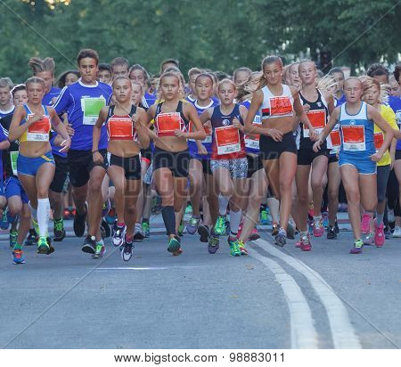 Group Of Running Girls And Boys Running On Road