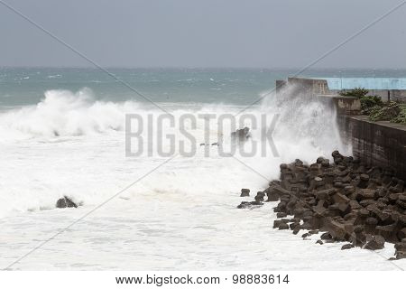 Stormy Sea During Typhoon, Waves Crashing On Barrier Wall