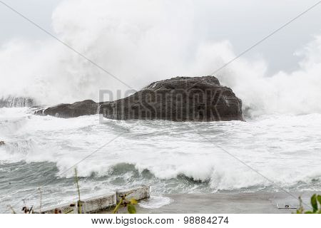 Stormy Sea With Waves Crashing On Rocks