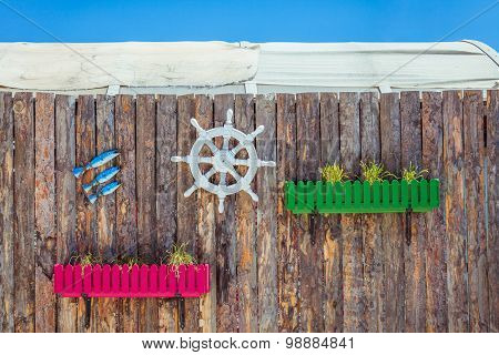 Decorative elements on the marine theme on the background of wooden